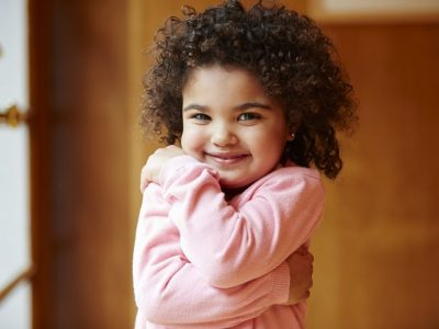 I Love Me 10 Ways to Build Your Childs SelfEsteem_Little girl hugging herself